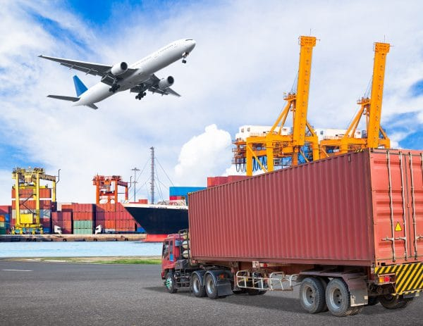 Truck transport container and cago plane flying above ship port with