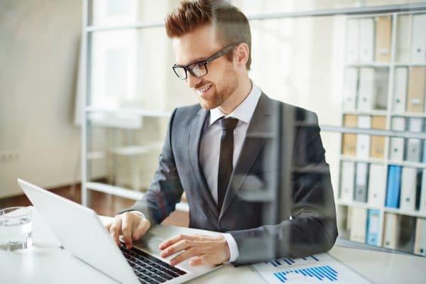 Happy eFunding businessman networking in office